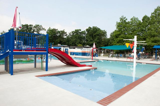 View of the north barnaby splash park pool with slide on a sunny day